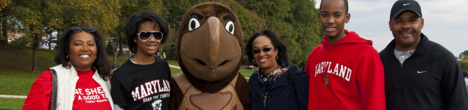 Family photo posed on McKeldin Mall with Testudo mascot
