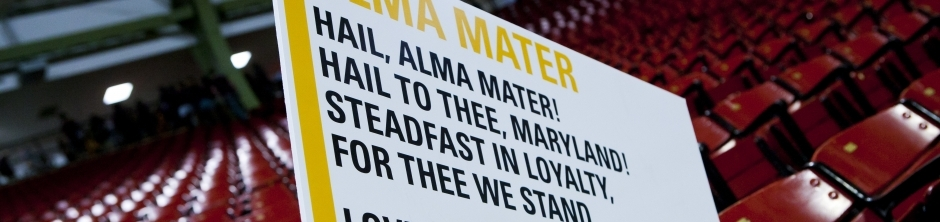 Maryland fight song written on poster boards to basketball audience